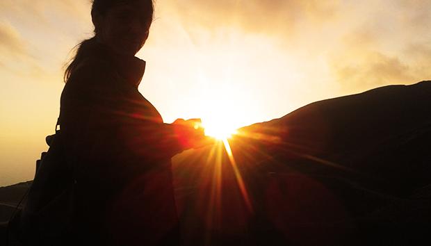 sole nella mano felicità