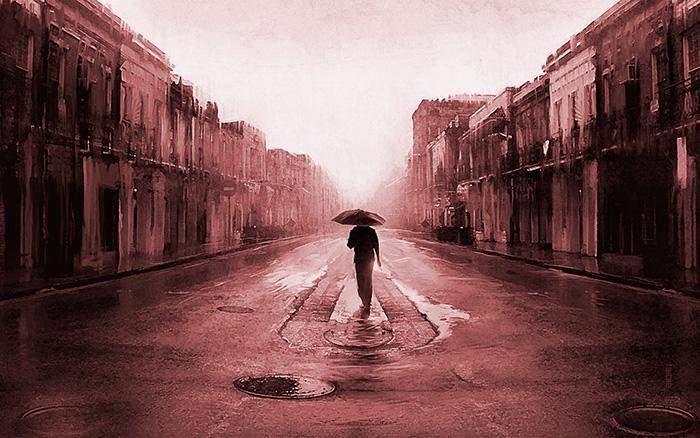 uomo con ombrello sotto la pioggia